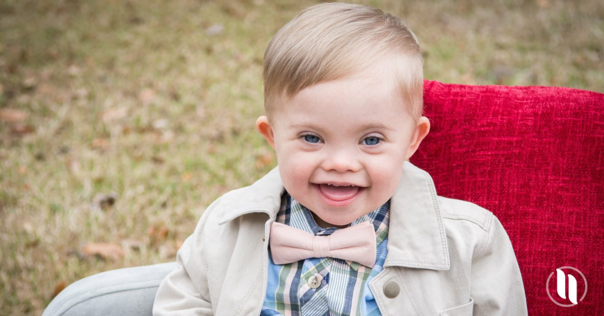 boy with down syndrome wearing bow tie
