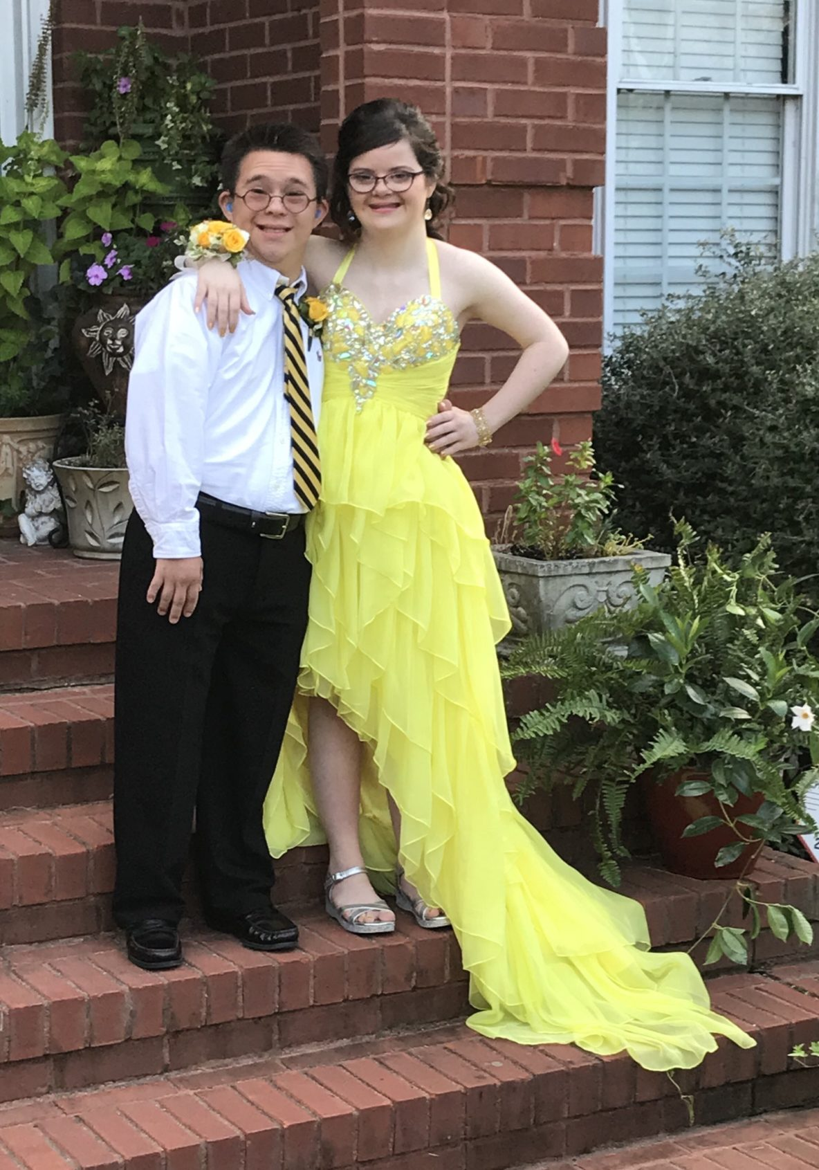 girl with down syndrome yellow dress