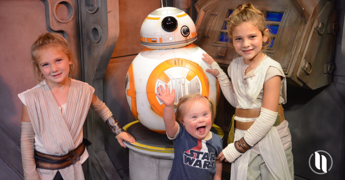 A two year old at Disney World meeting a Star Wars character